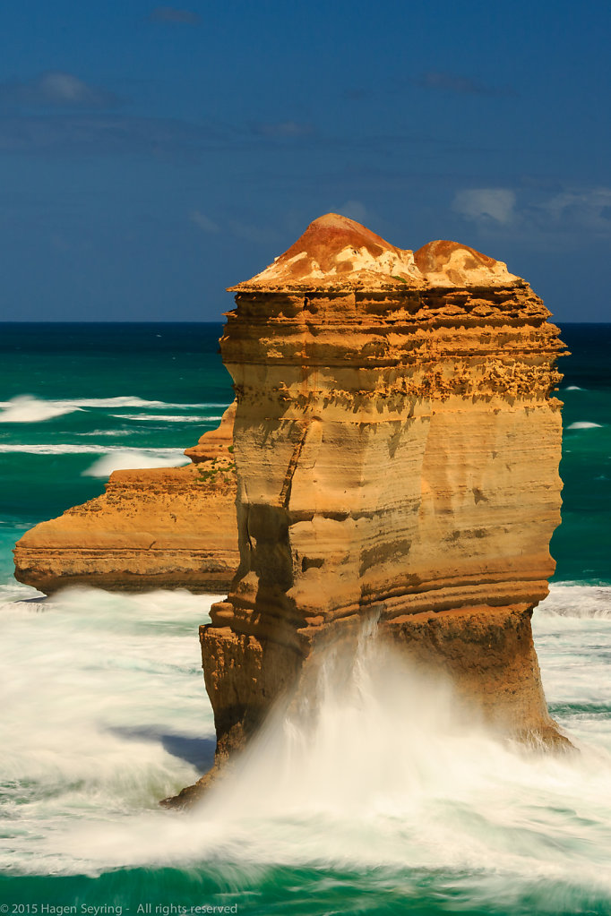 Breakers crashing on a rock needle on the Loch Ard Gorge